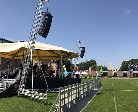 Truss-based 10m Bandstand stage roof for private school event.