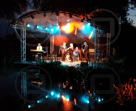 Covered stage over water.