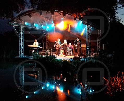 6m arc roof stage over water at Sunningwell Festival.