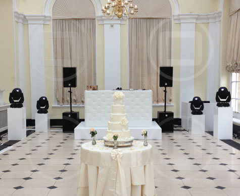 Simple white riser stage for wedding DJ.