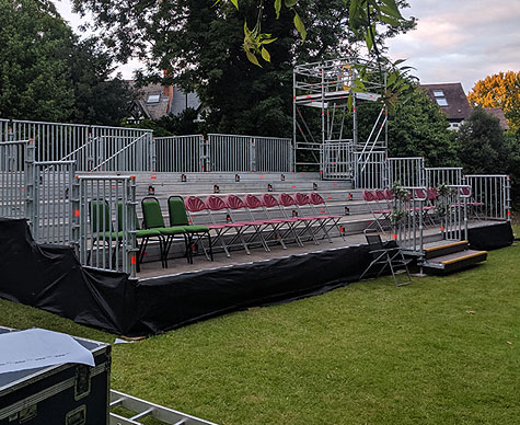 Outdoor tiered seating with camera towers.