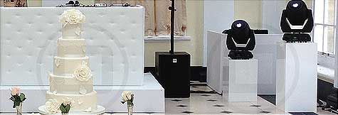 White Chesterfield-style DJ Booth on a 1ft riser for a white wedding